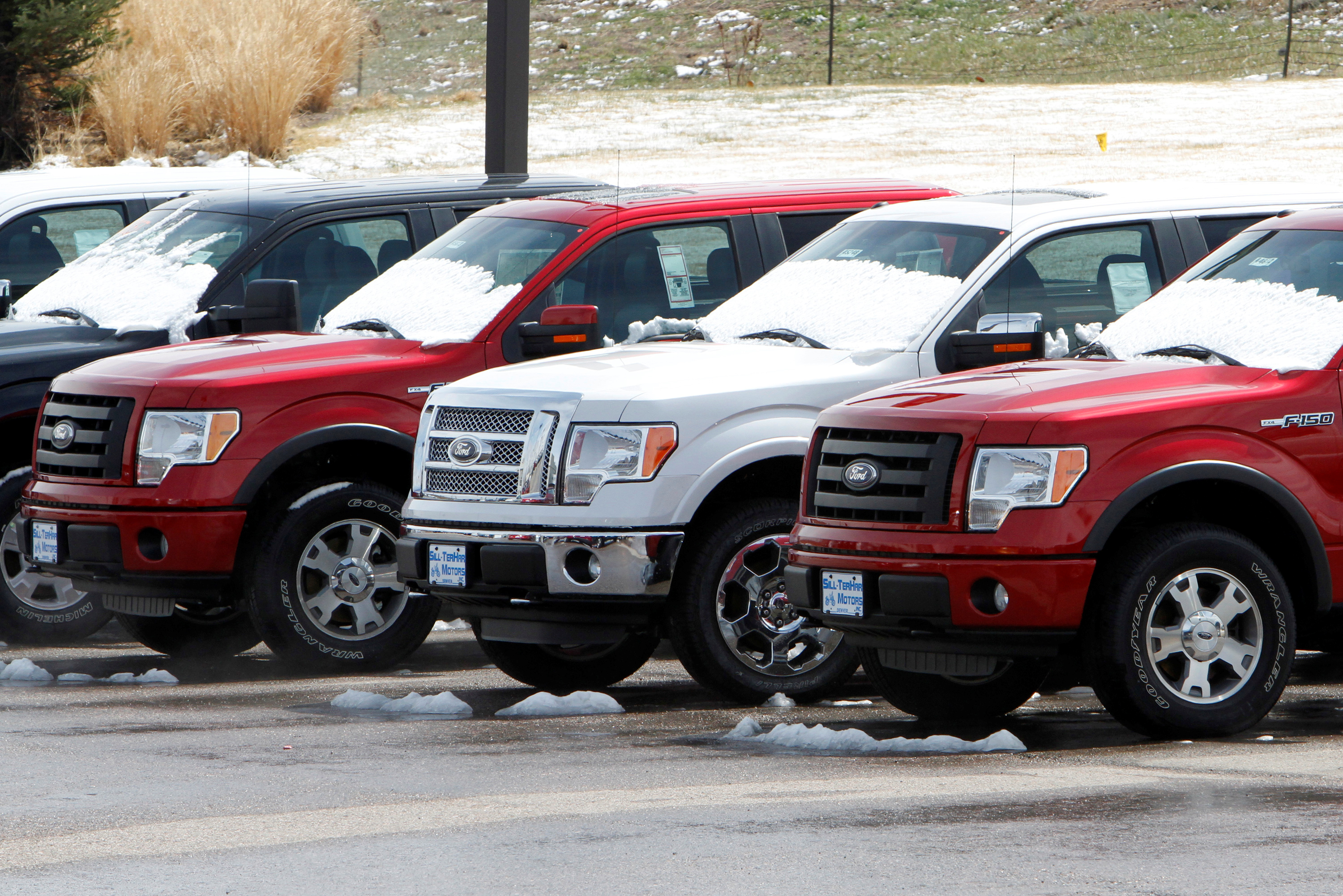 FILE PHOTO: A row of new Ford F-150 pickup trucks are parked for sale at a Ford dealer in the Denver suburb of Broomfield, Colorado, U.S., April 14, 2011. REUTERS/Rick Wilking/File Photo