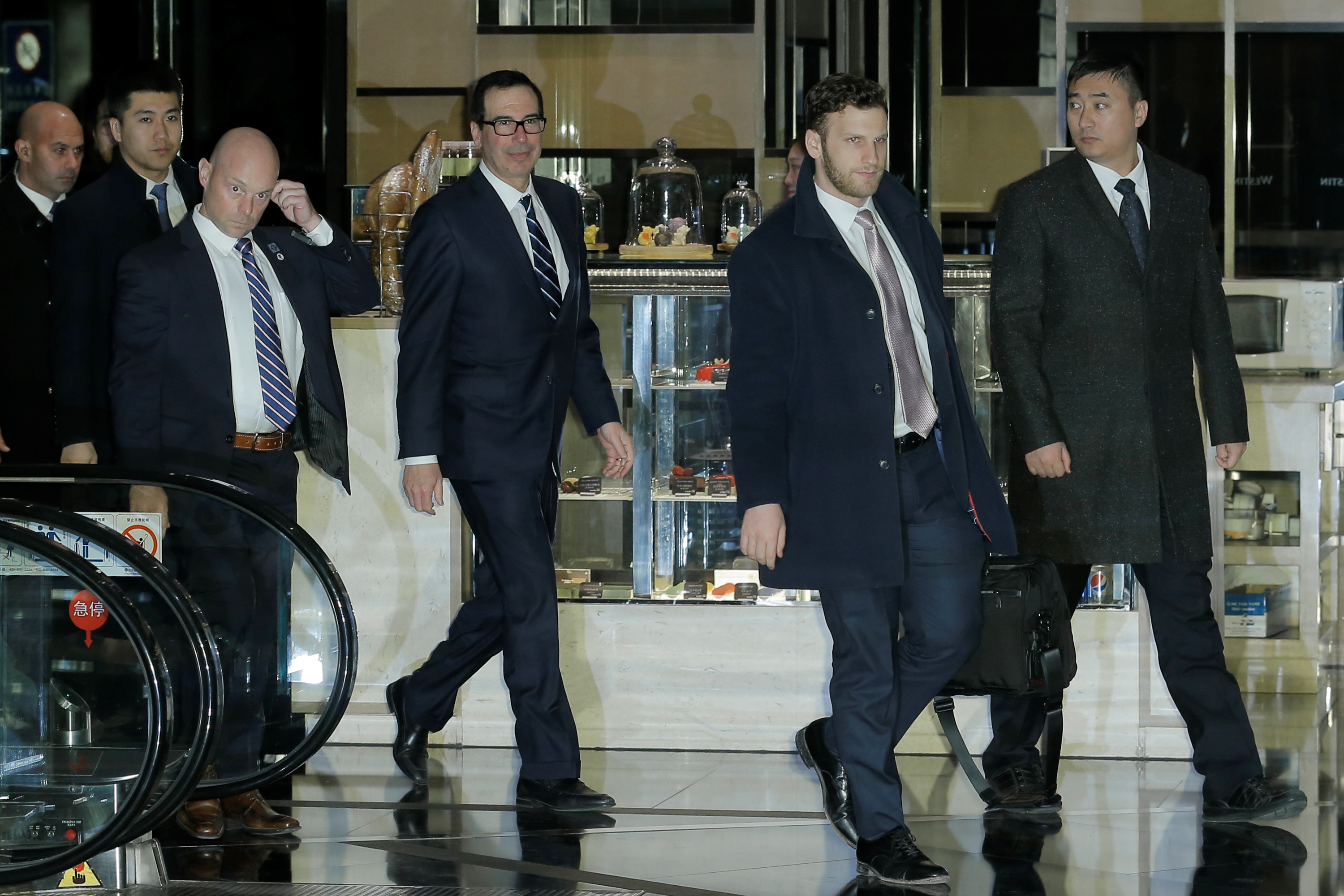 U.S. Treasury Secretary Steven Mnuchin and a member of the U.S. trade delegation to China arrives to a hotel in Beijing, China February 13, 2019. REUTERS/Thomas Peter