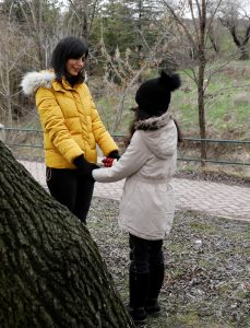Azam Jangravi holds hands with her daughter in a park, at the unknown location, February 7, 2019. REUTERS
