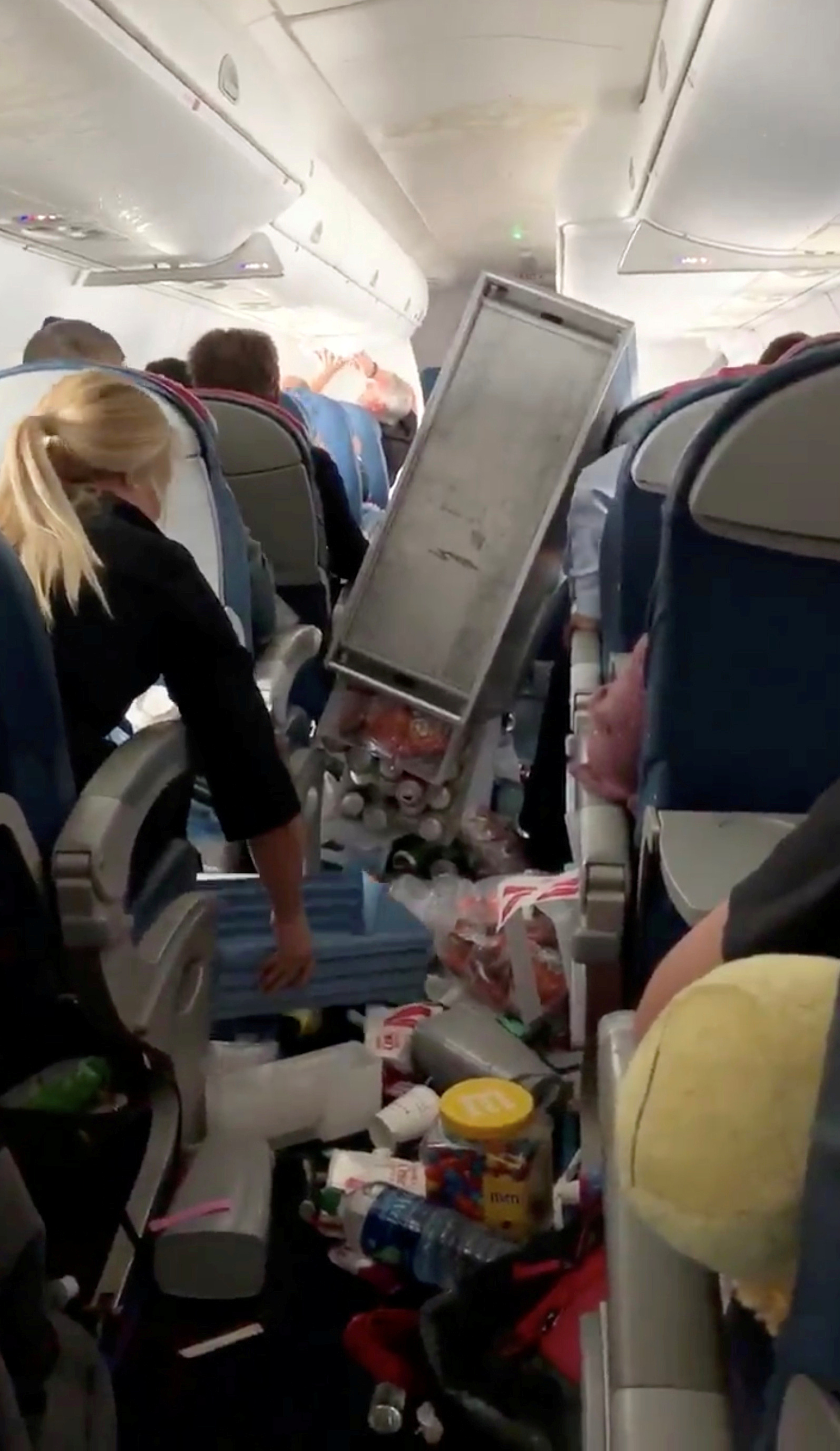 The aftermath of turbulence is seen on Compass Flight 5763 to Seattle, February 13, 2019 in this still picture obtained from social media video by Reuters February 14, 2019. JOE JUSTICE, SCRUM INC./via REUTERS