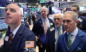 Traders work on the floor of the New York Stock Exchange (NYSE) in New York, U.S., February 13, 2019. REUTERS/Brendan McDermid