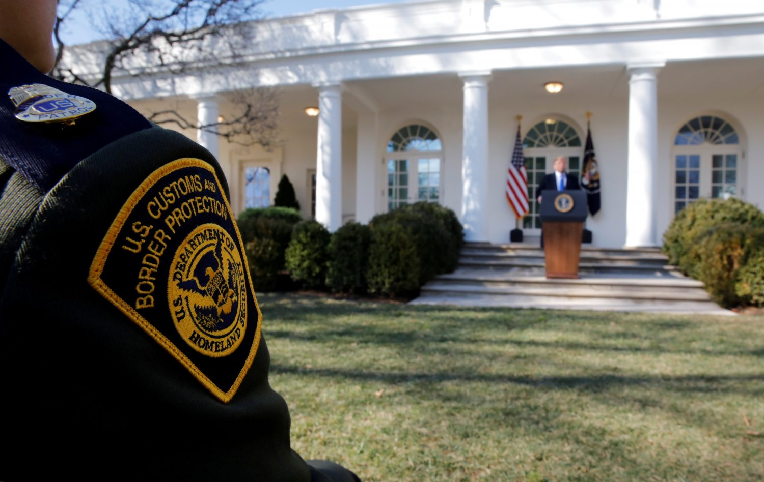 A U.S. Border Patrol agent listens from the front row as President Donald Trump declares a national emergency at the U.S.-Mexico border during remarks about border security in the Rose Garden of the White House in Washington, U.S., February 15, 2019. REUTERS/Carlos Barria