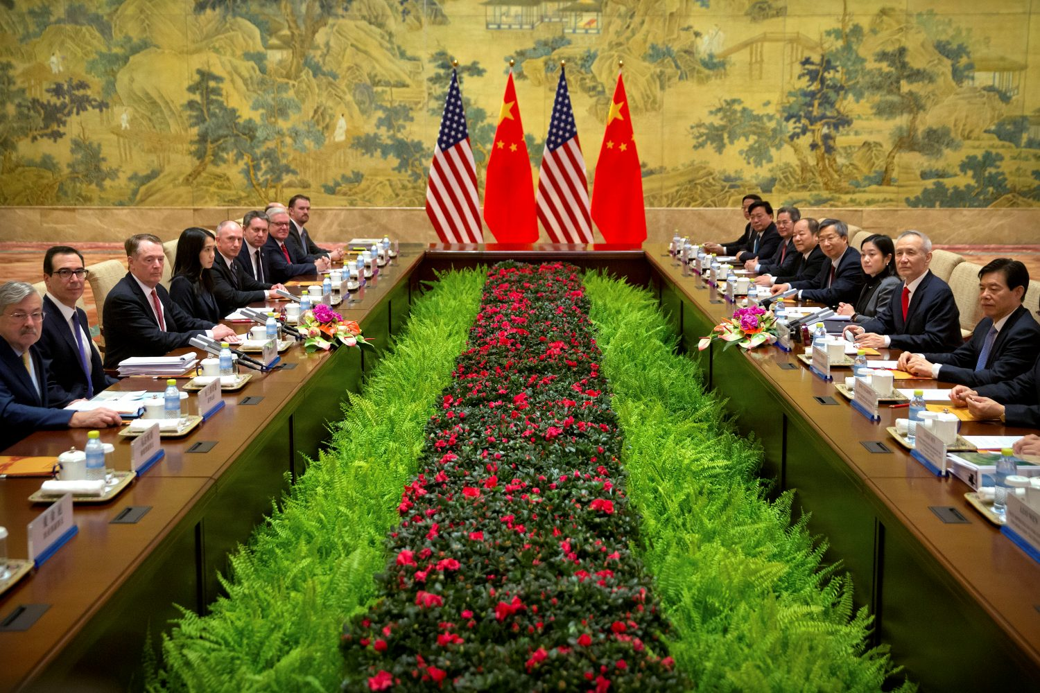 U.S. Treasury Secretary Steven Mnuchin, second from left, U.S. Trade Representative Robert Lighthizer, third from left, and Chinese Vice Premier and lead trade negotiator Liu He, second from right, pose for a photo before the opening session of trade negotiations at the Diaoyutai State Guesthouse in Beijing, Thursday, Feb. 14, 2019. Mark Schiefelbein/Pool via REUTERS