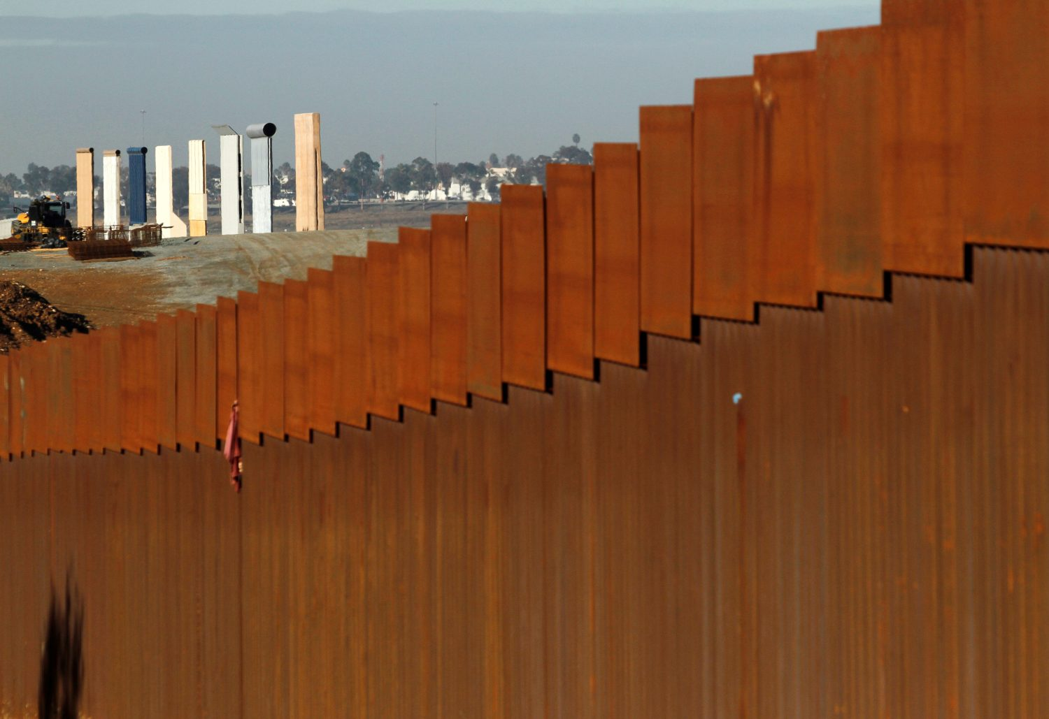 FILE PHOTO: The prototypes for U.S. President Donald Trump's border wall are seen behind the border fence between Mexico and the United States, in Tijuana, Mexico January 7, 2019. REUTERS/Jorge Duenes/File Photo