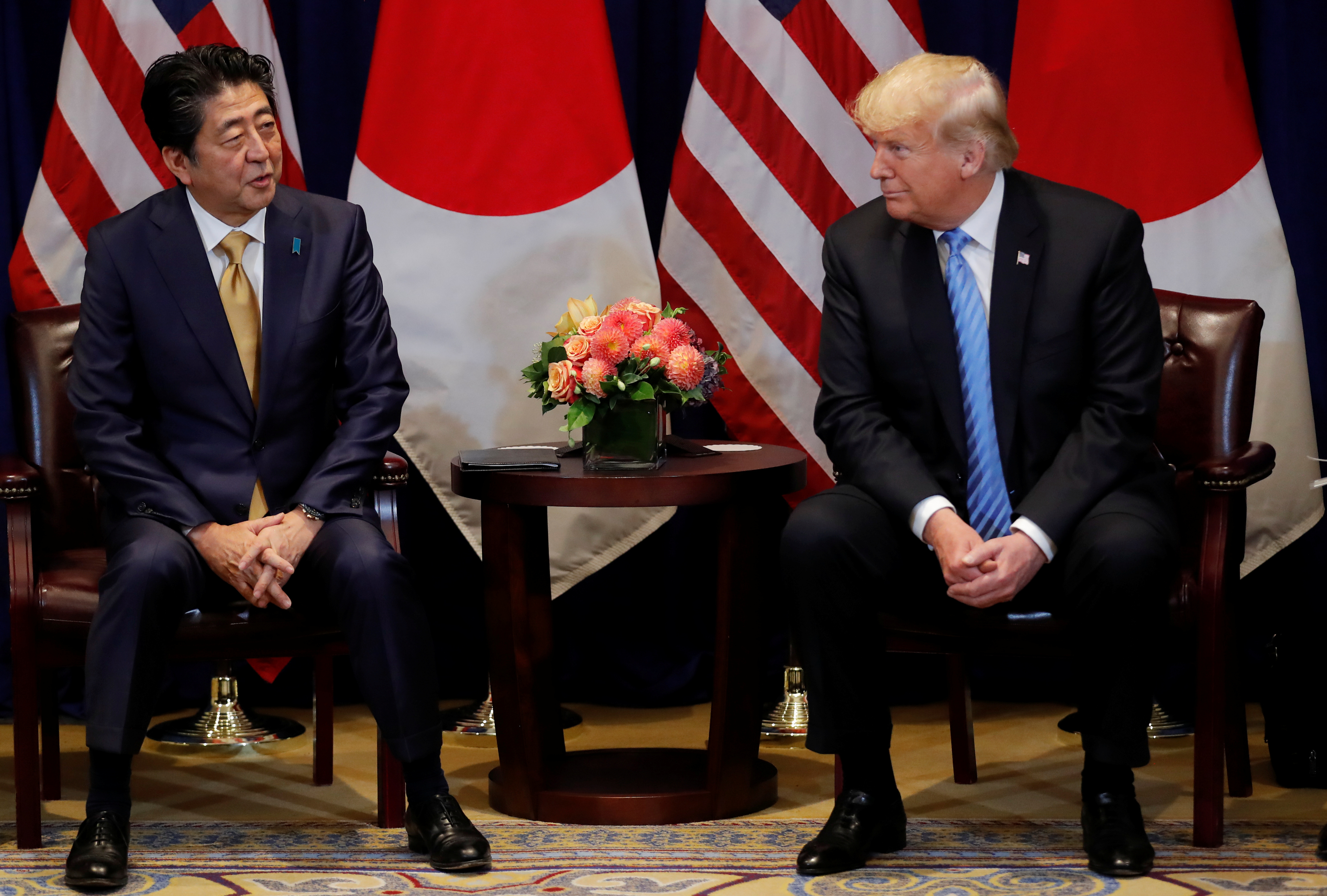 FILE PHOTO - U.S. President Donald Trump listens to Japan's Prime Minister Shinzo Abe during a bilateral meeting on the sidelines of the 73rd session of the United Nations General Assembly in New York, U.S., September 26, 2018. REUTERS/Carlos Barria