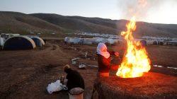 Yazidi women prepare bread at a refugee camp in Mount Sinjar, Iraq February 4, 2019. Picture taken February 4, 2019. REUTERS/Khalid al-Mousily