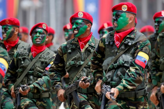 FILE PHOTO: Soldiers with their faces painted march during a military parade to celebrate the 205th anniversary of Venezuela's independence in Caracas, Venezuela July 5, 2016. REUTERS/Carlos Jasso/File Photo