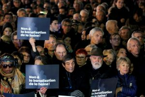 """People attend a national gathering to protest antisemitism and the rise of anti-Semitic attacks in the Place de la Republique in Paris, France, February 19, 2019. Placard reads: """"No to the trivialisation of hatred"""". REUTERS/Gonzalo Fuentes"""