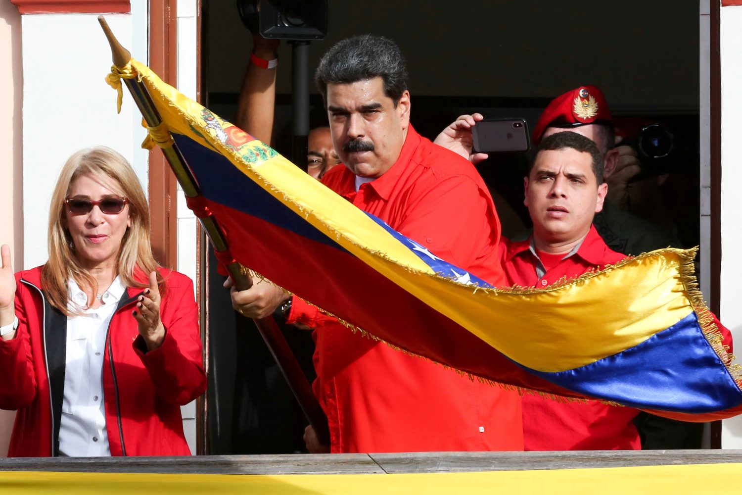 FILE PHOTO: Venezuela's President Nicolas Maduro attends a rally in support of his government and to commemorate the 61st anniversary of the end of the dictatorship of Marcos Perez Jimenez next to his wife Cilia Flores in Caracas, Venezuela January 23, 2019. Miraflores Palace/Handout via REUTERS/File Photo