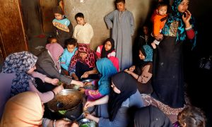 An Egyptian family prepares a cabbage meal for lunch in the province of Fayoum, southwest of Cairo, Egypt February 19, 2019. Picture taken February 19, 2019. REUTERS/Hayam Adel
