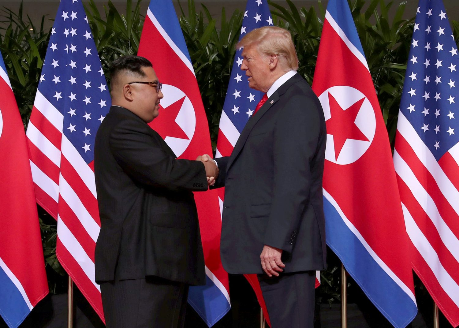 FILE PHOTO: U.S. President Donald Trump shakes hands with North Korean leader Kim Jong Un at the Capella Hotel on Sentosa island in Singapore June 12, 2018. REUTERS/Jonathan Ernst/File Photo