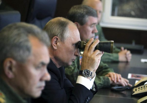 FILE PHOTO: Russian President Vladimir Putin uses a pair of binoculars while watching the Zapad-2017 war games, held by Russian and Belarussian servicemen, at a military training ground in the Leningrad region, Russia September 18, 2017. Sputnik/Mikhail Klimentyev/Kremlin/File Photo via REUTERS