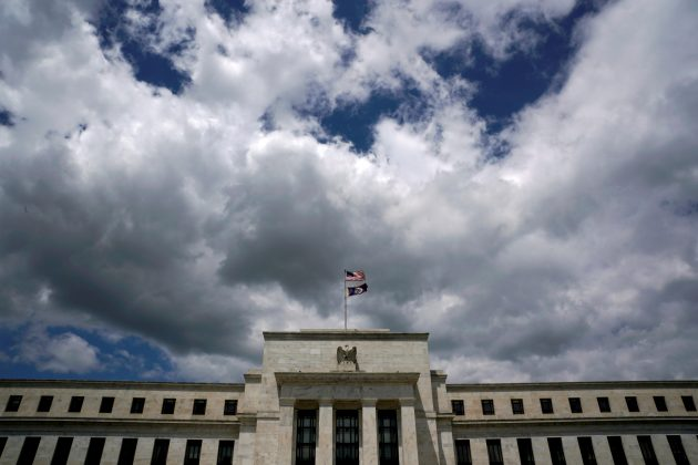 FILE PHOTO: Flags fly over the Federal Reserve Headquarters on a windy day in Washington, U.S., May 26, 2017. REUTERS/Kevin Lamarque/File Photo/File Photo