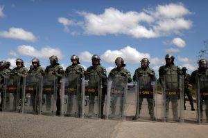 Venezuelan National guards block the road at the border between Venezuela and Brazil in Pacaraima, Roraima state, Brazil, February 22, 2019. REUTERS/Ricardo Moraes