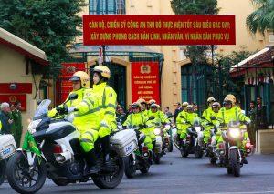 Vietnamese police leave their headquarters to patrol ahead of the upcoming North Korea-U.S. summit in Hanoi, Vietnam February 25, 2019. Doan Tan/VNA via REUTERS