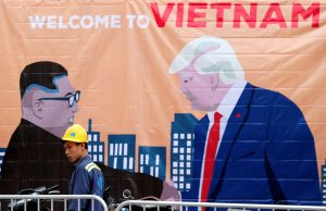 A man walks past a banner depicting North Korean leader Kim Jong Un and U.S. President Donald Trump ahead of the North Korea-U.S. summit in Hanoi, Vietnam, February 25, 2019. REUTERS/Kim Kyung-Hoon