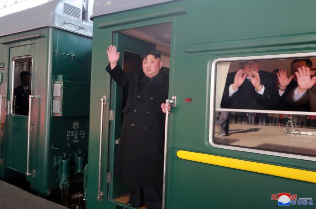 North Korean leader Kim Jong Un waves from a train as he departs for a summit in Hanoi, in Pyongyang, North Korea in this photo released by North Korea's Korean Central News Agency (KCNA) on February 23, 2019. KCNA via REUTERS