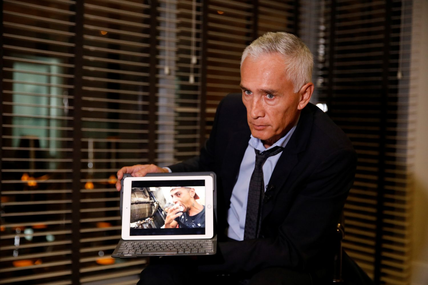 Jorge Ramos, anchor of Spanish-language U.S. television network Univision, shows a video of young Venezuelans eating from a garbage truck, while talking to the media, in Caracas, Venezuela February 25, 2019. REUTERS/Carlos Garcia Rawlins