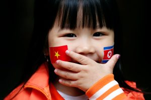 A child with stickers of the North Korean and Vietnamese flags on her face reacts at the Vietnam-North Korea Friendship kindergarten, founded by North Korean Government in Hanoi, ahead of the North Korea-U.S. summit in Hanoi, Vietnam February 27, 2019. REUTERS/Athit Perawongmetha