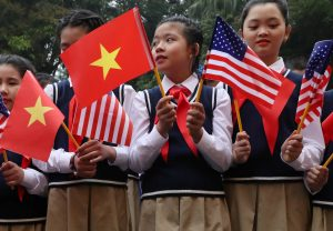 Students from Nguyen Du secondary school hold U.S. and Vietnam flags outside the Presidential Palace, as they wait for wait to greet U.S. President Donald Trump, in Hanoi, Vietnam, February 27, 2019. REUTERS/Leah Millis
