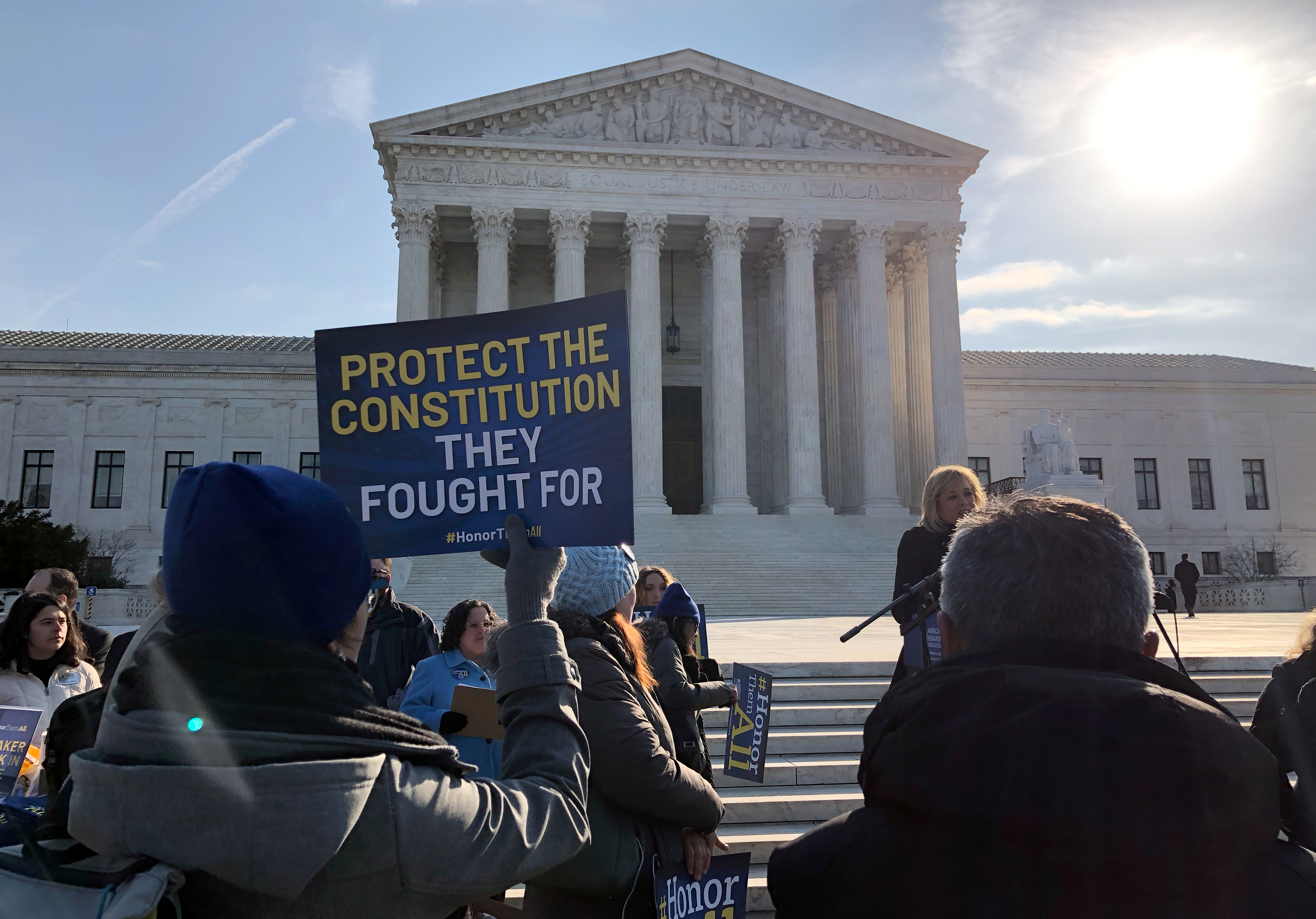 Advocates for the separation of church and state participate in a rally outside the U.S. Supreme Court ahead of oral arguments over whether a concrete cross commemorating servicemen killed in World War One in Bladensburg, Maryland, is an unconstitutional government endorsement of religion, in Washington, U.S., February 27, 2019. REUTERS/Lawrence Hurley