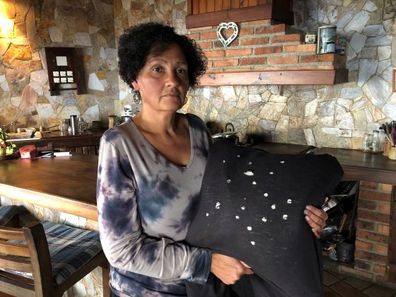 Eugenia Vicuna holds a cushion made from the t-shirt that, she says, her son was wearing at the moment of his detention at their house in El Junquito, Venezuela, February 7, 2019. Picture taken February 7, 2019. To match Insight VENEZUELA-POLITICS/EVIDENCE. REUTERS/Angus Berwick