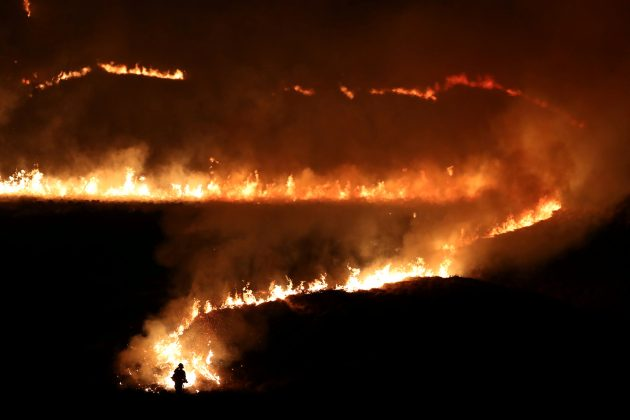 A fire is seen burning on Saddleworth Moor near the town of Diggle, Britain, February 27, 2019. REUTERS/Jon Super