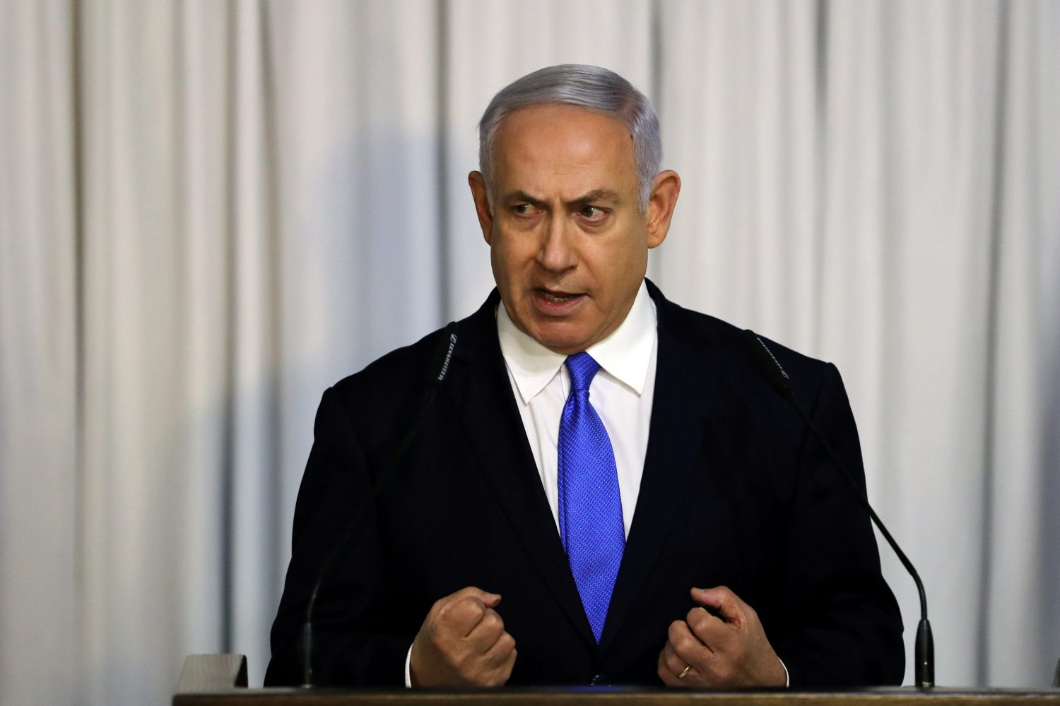 FILE PHOTO: Israeli Prime Minister Benjamin Netanyahu gives a statement to the media in Tel Aviv, Israel February 21, 2019 REUTERS/ Ammar Awad/File Photo