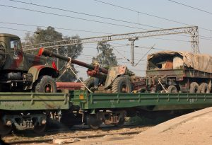 A train loaded with Indian army trucks and artillery guns is parked at a railway station on the outskirts of Jammu February 28, 2019. REUTERS/Mukesh Gupta