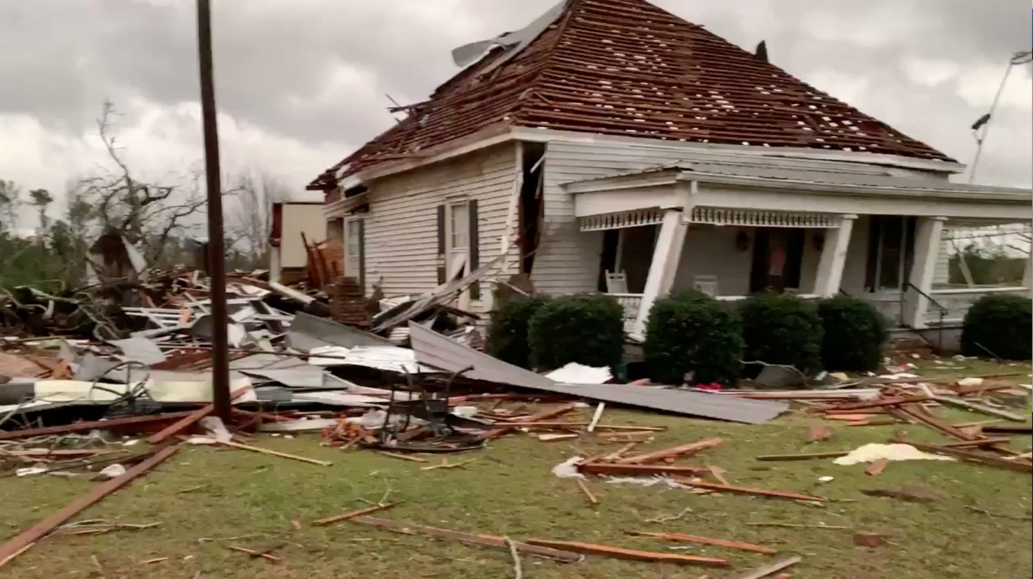 Debris and a damaged house seen following a tornado in Beauregard, Alabama, U.S. in this March 3, 2019 still image obtained from social media video. SCOTT FILLMER /via REUTERS