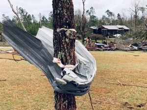A piece of metal is seen wrapped around a tree following a tornado in Beauregard, Alabama, U.S. in this March 3, 2019 still image obtained from social media video on March 4, 2019. SCOTT FILLMER /via REUTERS