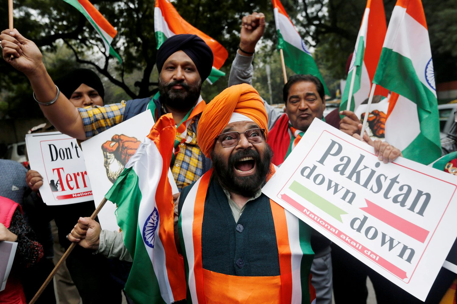 FILE PHOTO: People hold national flags and placards as they celebrate after Indian authorities said their jets conducted airstrikes on militant camps in Pakistani territory, in New Delhi, India, February 26, 2019. REUTERS/Adnan Abidi/File Photo