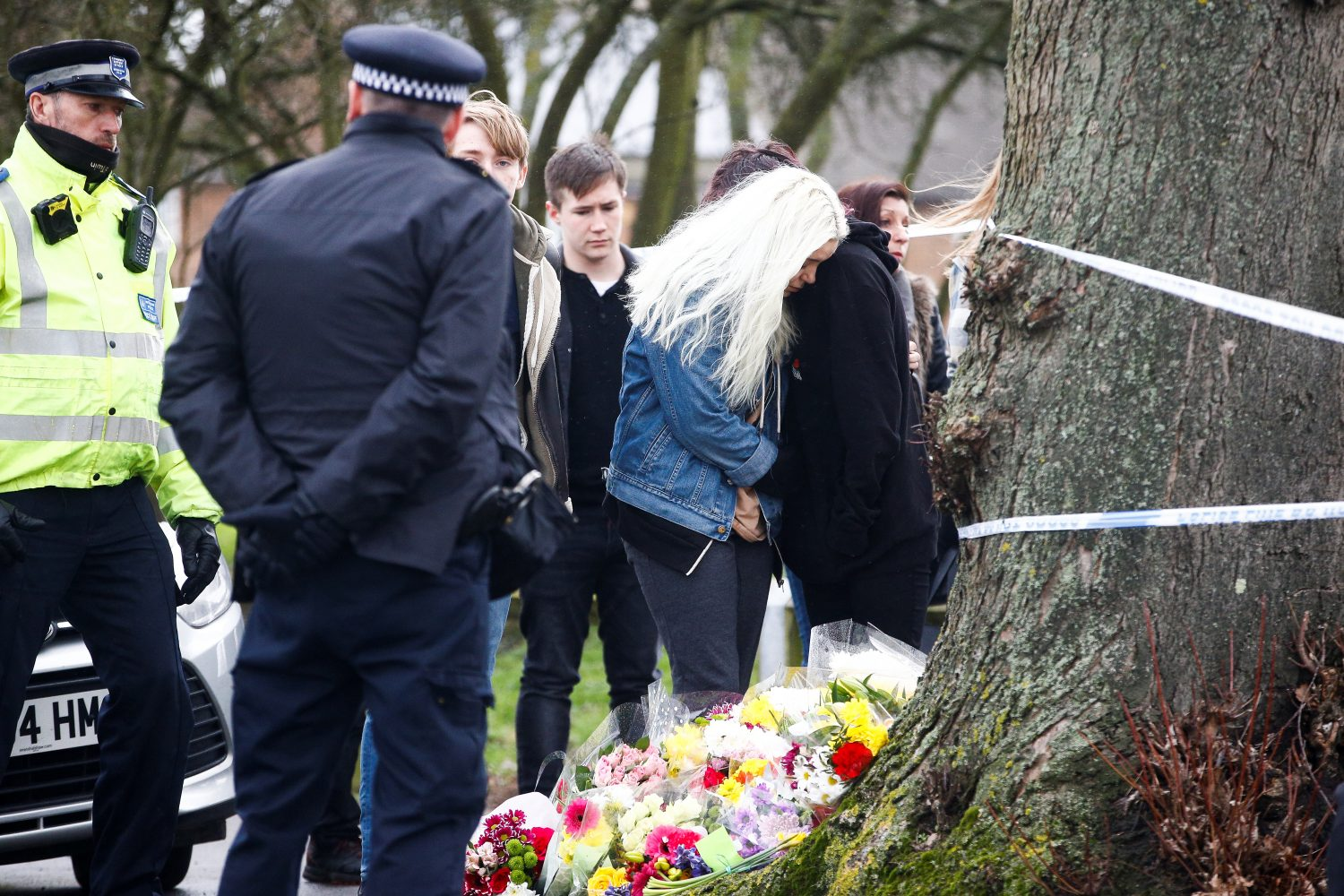 FILE PHOTO: People visit a site near to where 17-year-old Jodie Chesney was killed, at the Saint Neots Play Park in Harold Hill, east London, Britain March 3, 2019. REUTERS/Henry Nicholls