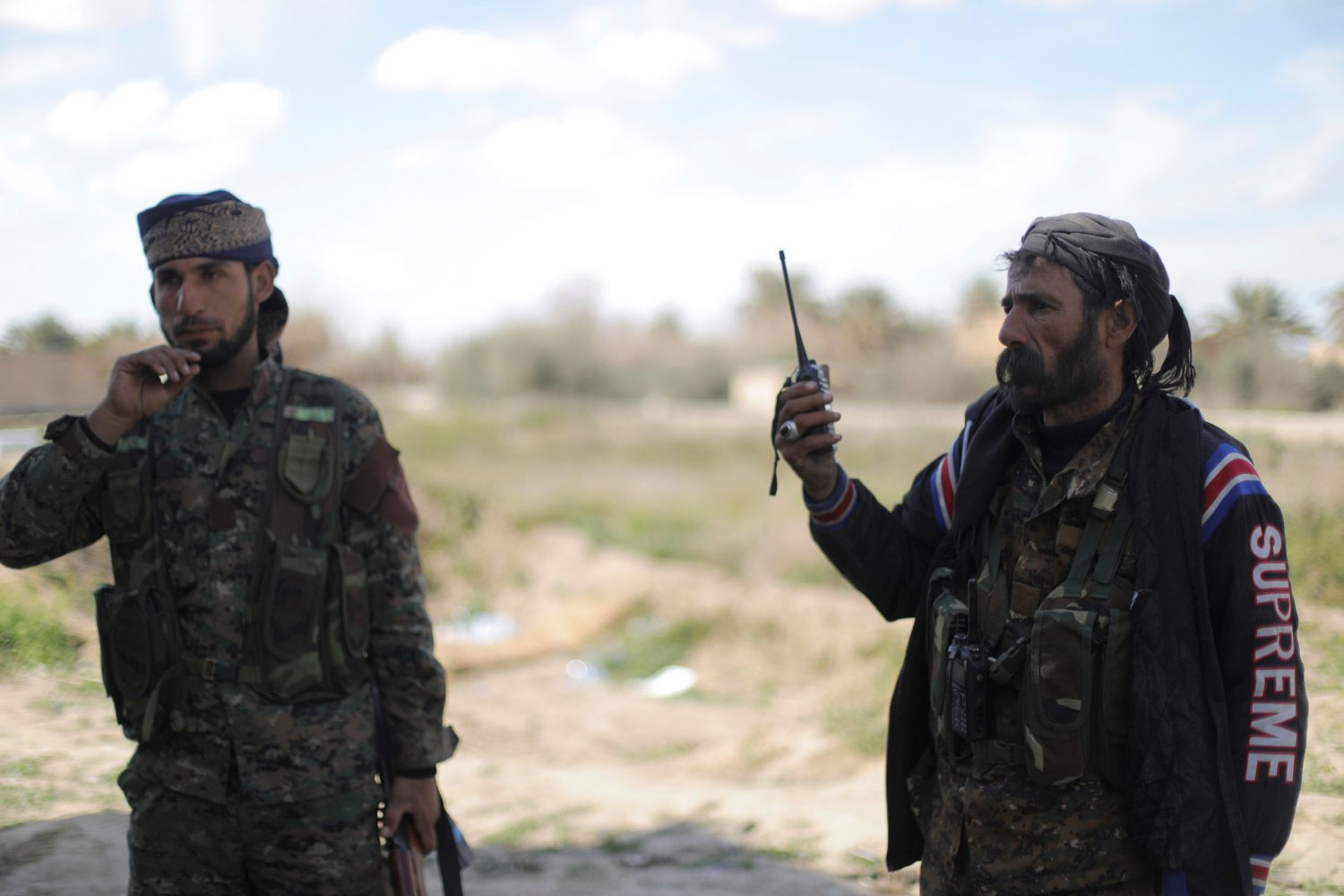 FILE PHOTO: A fighter of Syrian Democratic Forces (SDF) holds a walkie-talkie in Baghouz, Deir Al Zor province, Syria March 3, 2019. REUTERS/Rodi Said