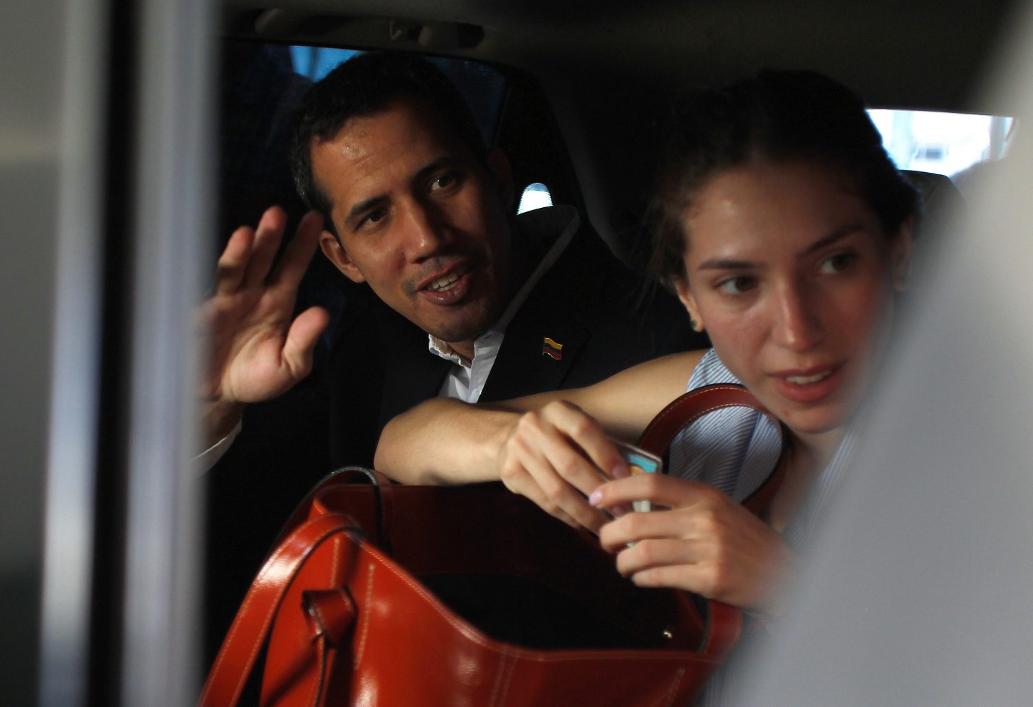 Venezuelan opposition leader Juan Guaido, who many nations have recognized as the country's rightful interim ruler, waves next to his wife Fabiana Rosales while leaving a hotel in Salinas, Ecuador March 3, 2019. REUTERS/Daniel Tapia