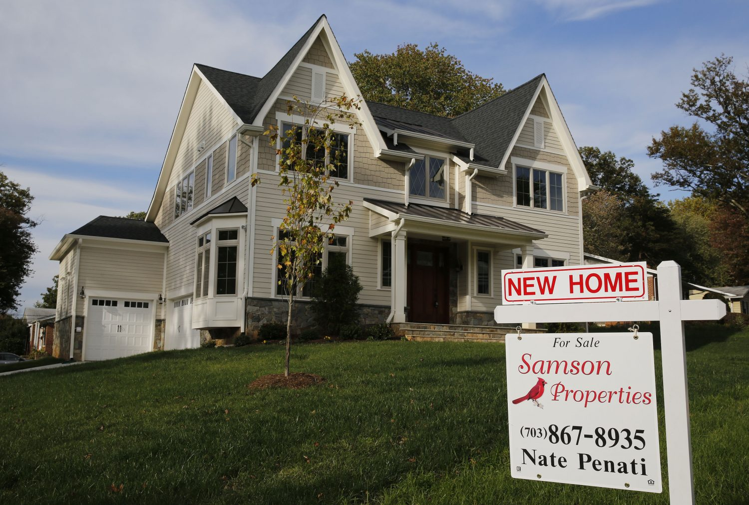 FILE PHOTO: A real estate sign advertising a new home for sale is pictured in Vienna, Virginia, U.S. October 20, 2014. REUTERS/Larry Downing