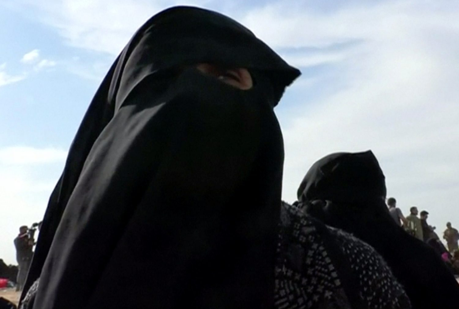 Um Walaa, originally from Morocco with French nationality, and widow of an Islamic state fighter, is seen near Baghouz, Syria in this still image taken from a video shot on March 5, 2019. ReutersTV via REUTERS