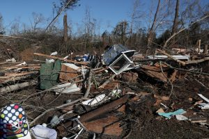 Debris lays outside a house devastated after two deadly back-to-back tornadoes, in Beauregard, Alabama, U.S., March 5, 2019. REUTERS/Shannon Stapleton