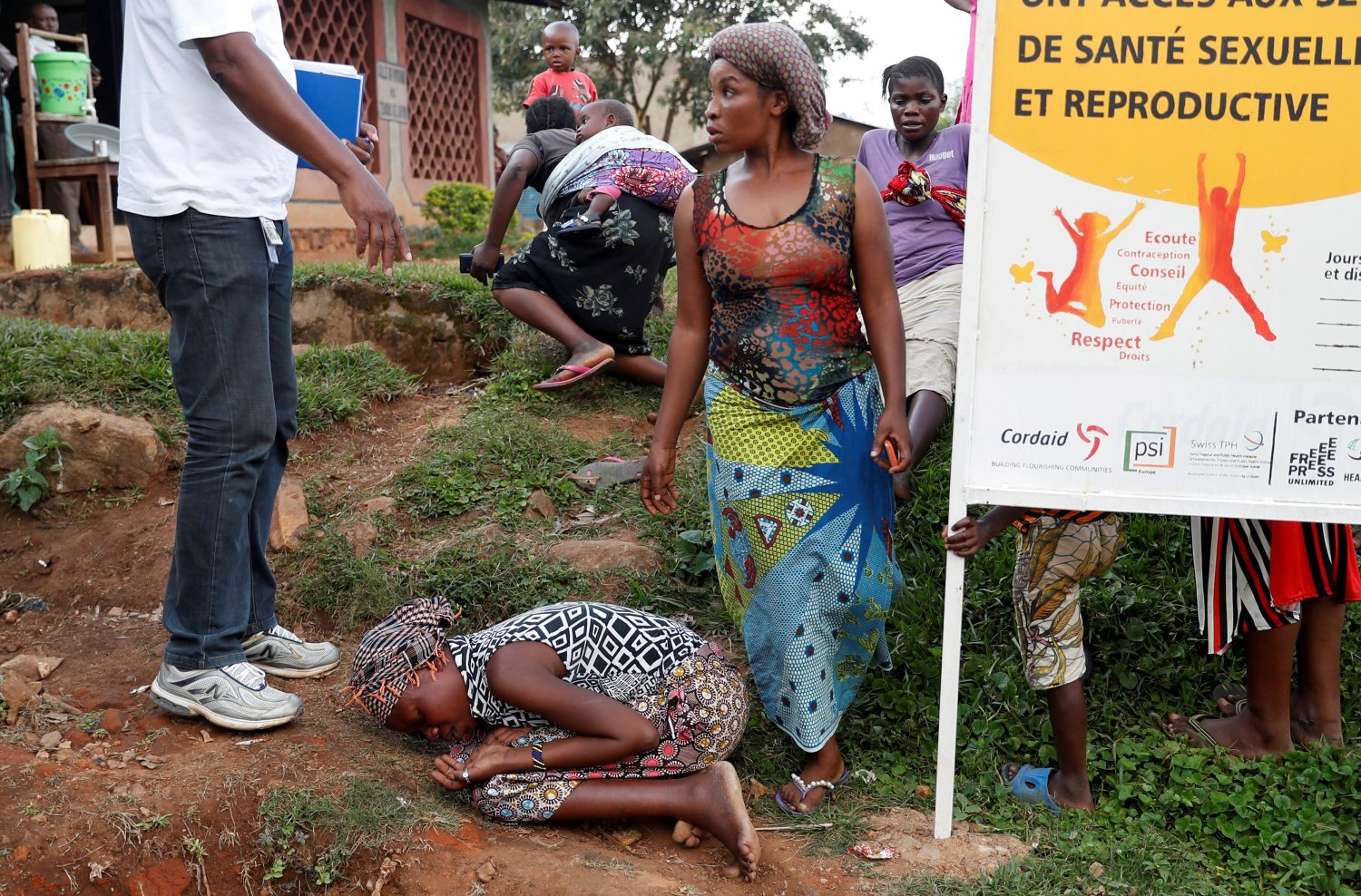 FILE PHOTO: A mother of a child, suspected of dying from Ebola, cries outside a hospital during the funeral in Beni, North Kivu Province of Democratic Republic of Congo, December 17, 2018. REUTERS/Goran Tomasevic