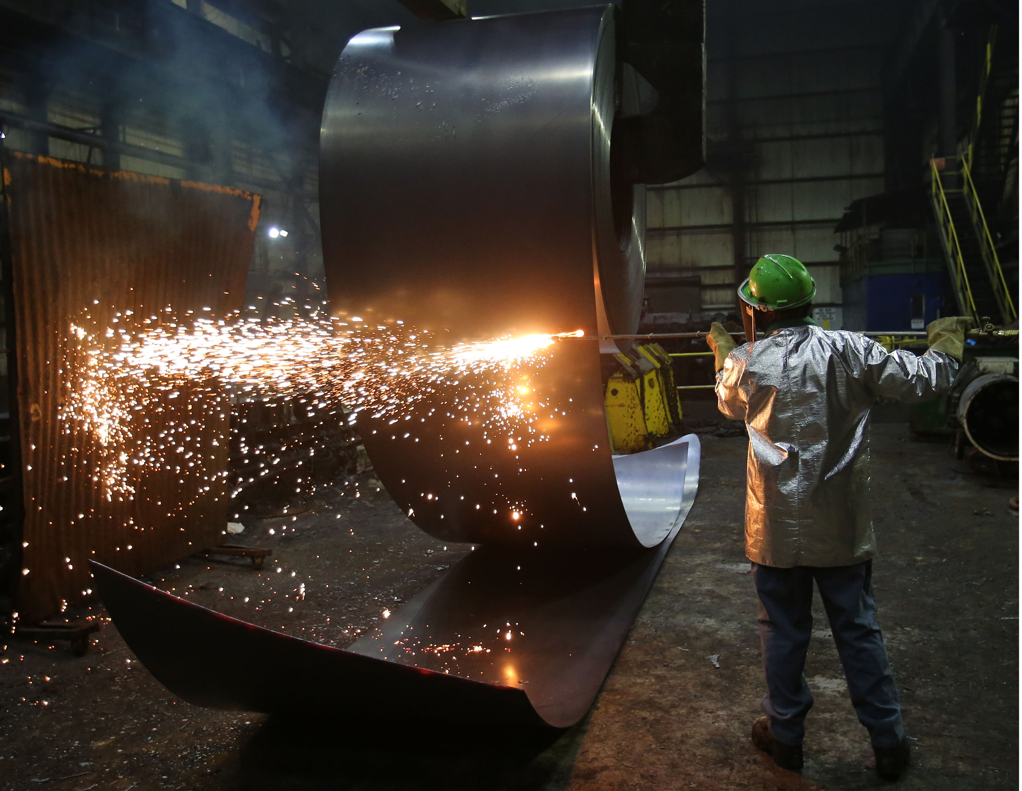 FILE PHOTO: A worker cuts a steel coil at the Novolipetsk Steel PAO steel mill in Farrell, Pennsylvania, U.S., March 9, 2018. REUTERS/Aaron Josefczyk
