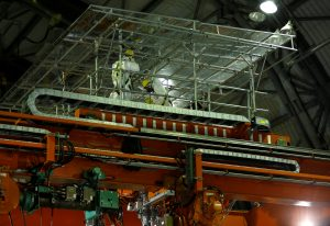 Workers conduct crane operation training to remove nuclear fuels at the operation floor inside No.3 reactor building at Tokyo Electric Power Co's (TEPCO) tsunami-crippled Fukushima Daiichi nuclear power plant in Okuma town, Fukushima prefecture, Japan February 18, 2019. Picture taken February 18, 2019. REUTERS/Issei Kato
