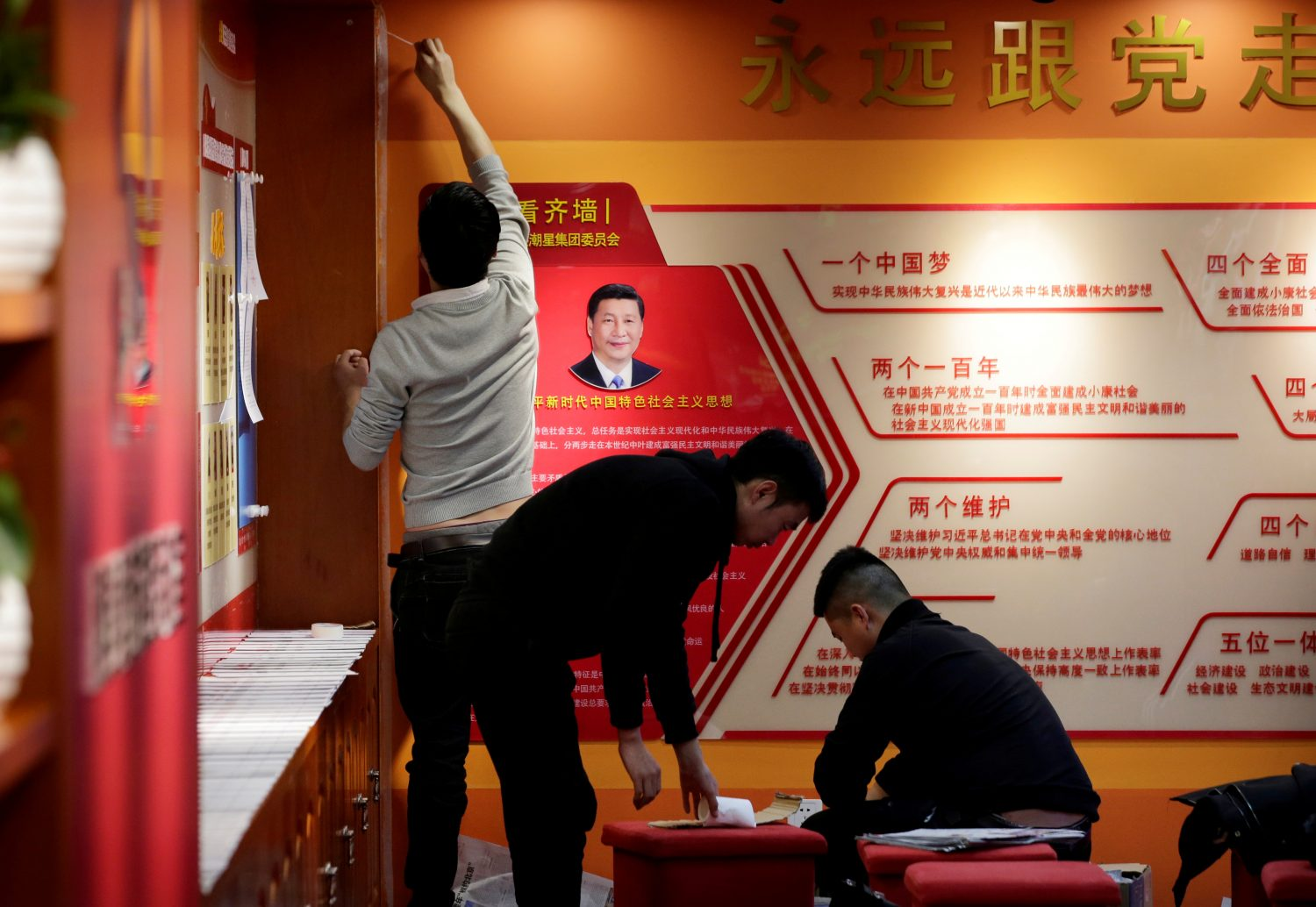 FILE PHOTO: Workers decorate the party activity room next to a portrait of Chinese president Xi Jinping at Tidal Star Group headquarters in Beijing, China, February 25, 2019. REUTERS/Jason Lee/File Photo