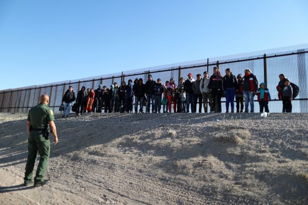 A group of Central American migrants surrenders to U.S. Border Patrol Agent Jose Martinez south of the U.S.-Mexico border fence in El Paso, Texas, U.S., March 6, 2019. REUTERS/Lucy Nicholson