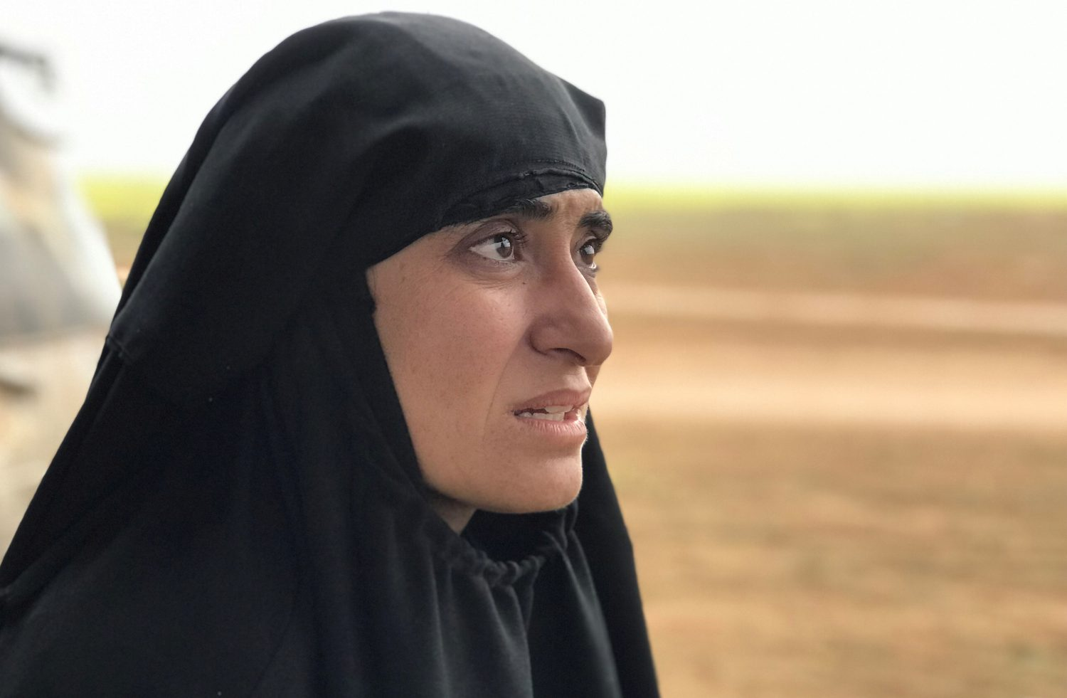 Yazidi woman Salwa Sayed al-Omar, who escaped from the Islamic State, talks during an interview with Reuters near the village of Baghouz, Deir Al Zor province, in Syria March 7, 2019. REUTERS/STRINGER
