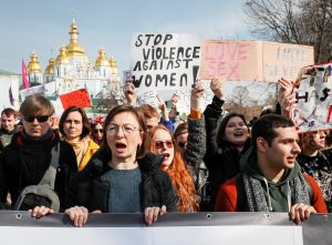 Activists attend a rally for gender equality and against violence towards women on the International Women's Day in Kiev, Ukraine March 8, 2019. REUTERS/Gleb Garanich
