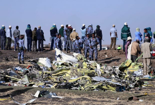 Ethiopian Federal policemen stand at the scene of the Ethiopian Airlines Flight ET 302 plane crash, near the town of Bishoftu, southeast of Addis Ababa, Ethiopia March 11, 2019. REUTERS/Tiksa Negeri