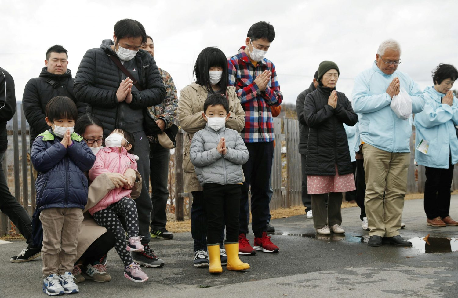 People pray to mourn victims at 2:46 PM (05:46 GMT), the time when the magnitude 9.0 earthquake struck off Japan's coast in 2011, in Iwaki, Fukushima prefecture, Japan March 11, 2019, to mark the eighth year anniversary of the earthquake and tsunami that killed thousands and set off a nuclear crisis. Kyodo/via REUTERS