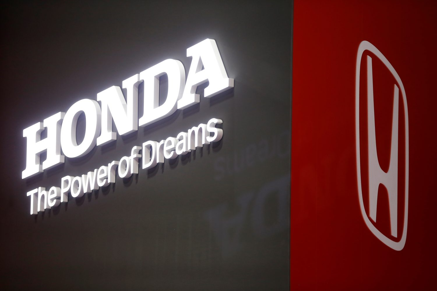 The Honda logo is displayed at the 89th Geneva International Motor Show in Geneva, Switzerland March 5, 2019. REUTERS/Pierre Albouy
