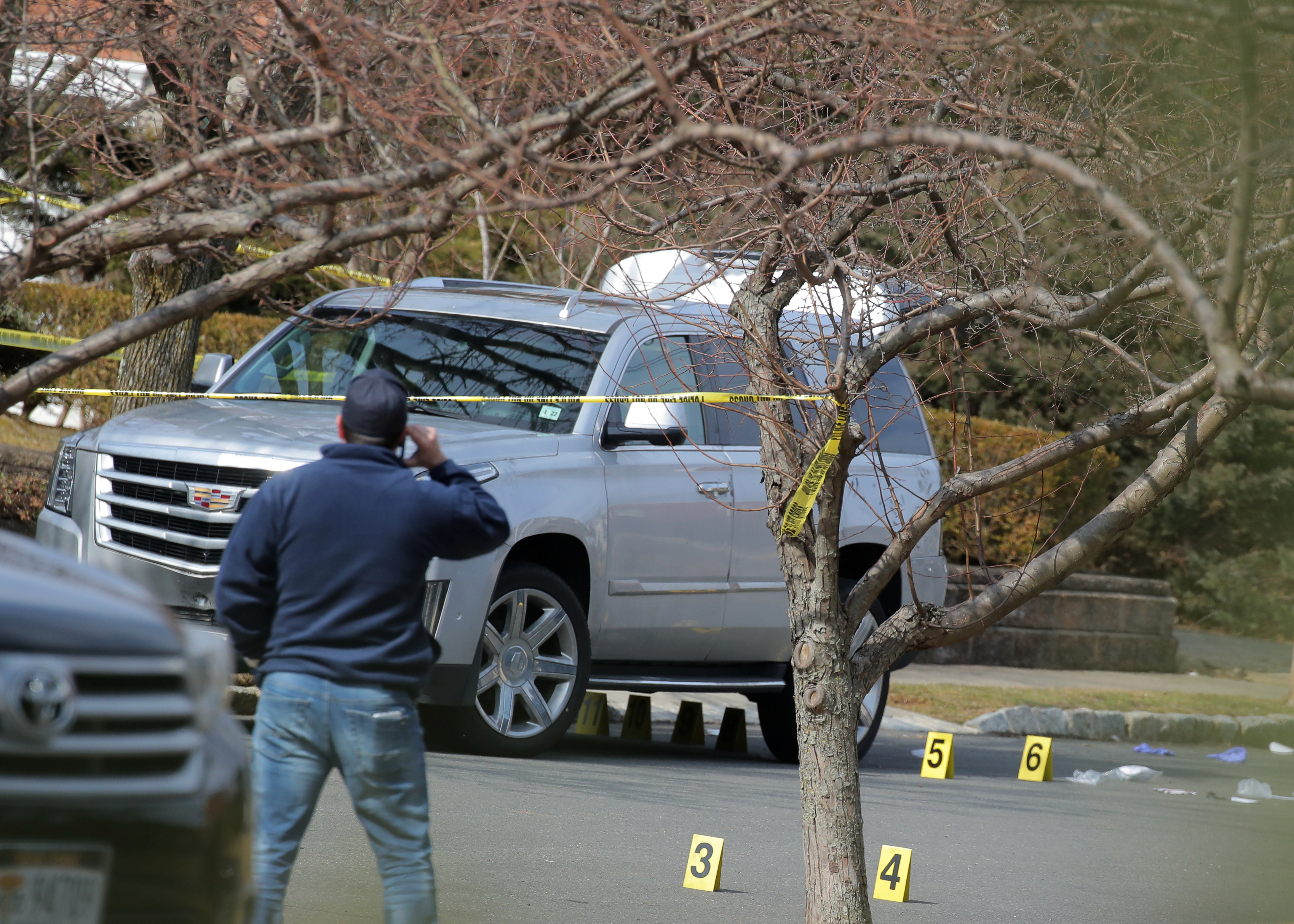 """New York City Police officers (NYPD) investigate the scene where, reported New York Mafia Gambino family crime boss, Francesco """"Franky Boy"""" Cali, was killed outside his home in the Staten Island borough of New York City, U.S., March 14, 2019. REUTERS/Brendan McDermid"""