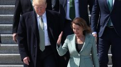 U.S. President Donald Trump walks down the U.S Capitol steps with Speaker of the House Nancy Pelosi (D-CA) after they both attended the 37th annual Friends of Ireland luncheon at the U.S. Capitol in Washington, U.S., March 14, 2019. REUTERS/Jonathan Ernst